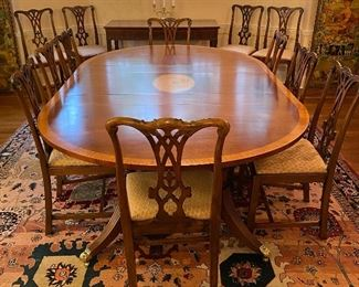 Custom hand crafted dining table and 12 Antique sidechairs