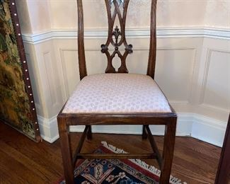 One of a set of 12 antique side chairs