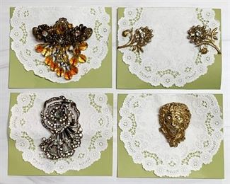 Top row - Hattie Carnegie brooch, Miriam Haskell earrings. Bottom row - sterling fur clip, Irwin Pearl brooch.