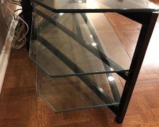 detail of Black metal & 3 glass shelf media stand - angled glass shelves