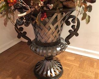 detail of autumn floral arrangement in metal urn