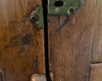 antique hardware on cupboard