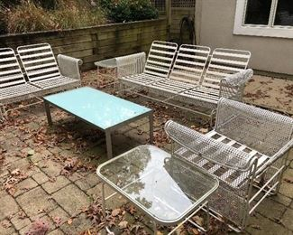 BUY IT NOW! $475 vintage patio furniture, 6 pcs       metal mesh arms with vinyl strap seating2 glass topped tables, 1 small metal mesh side table, 1 glider chair, 1 glider loveseat, 1 glider sofa, includes sunbrella cushions (center coffee table as is and not included in price)