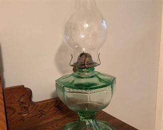 Green glass oil lamp available on sale day