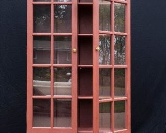 Rust colored Lawyer's Cabinet.