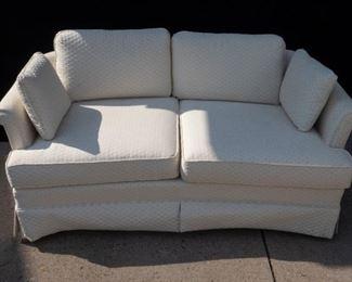 White upholstered love seat