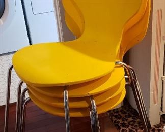 Four mid century stack chairs