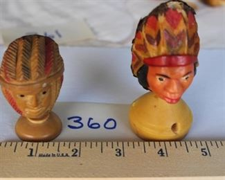 360 - Pair of decorated heads, $25, Tagua nut hand carved and decorated. Sit on base