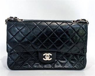 """Chanel black diamond quilted handbag or crossbody with gold hardware (looks silver from white reflection). Size is 10 3/8"""" length, 6 3/8"""" height, and 1 1/2"""" depth. Strap is approximately 43 1/2"""". Twist closure is in the middle of the Chanel logo. Open the top flap to reveal """"Chanel Paris"""" from the back of the logo closure, a small zipper pocket, a smaller flap, and a large open pocket behind it. The smaller flap is secured with a snap closure. Upon opening it, one sees a burgundy leather lining with an embroidered Chanel logo in the center. The burgundy section has a larger open section, two smaller pockets, and one pen pocket. There's also a medium open pocket in front of the burgundy section. Strap can be adjusted to serve as a purse or crossbody bag. Condition is excellent with very little sign of use. $3150"""
