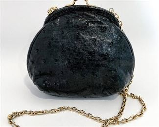 """Judith Leiber black ostrich leather ball clasp bag. Opens to black fabric lining with an open pocket at the back. Size is 6.5"""" length, 6.5"""" height, and 3.75"""" depth. Gold link strap is 39"""" long. Condition is excellent. $495"""