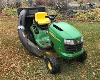 John Deere riding lawn mower with bagger attachment