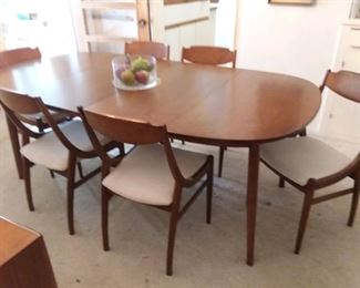 "Drexel Parallel Collection Mid Century Modern Dining Table with 2-16"" Leaves.  Nice walnut finish! (This is a bit blurry... We'll post a clearer photo soon!)"