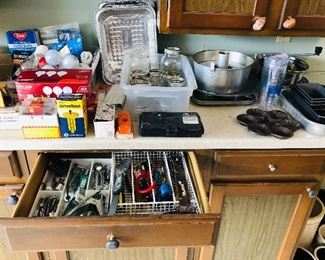 Metal baking pans $2. Angel food cake pan $4. Cast iron baking pan $6. Canning jars asst. sizes $7. Light bulbs $8 all. Assorted hand tools, clamps, drill bits, and misc. $1 ea.