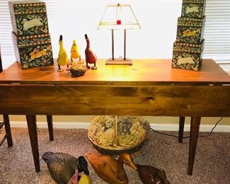 """5 Bob's Boxes """"Ella Angel"""" nesting boxes (sold) $22. Four piece duck family $24 (sold). Stained glass office lamp $65. Duck decoys left to right: $20 (plastic/cracked), $35 (wood/cracked), $25 (hand-carved). Vintage drop-leaf table 60"""" x 19"""" with leaves down $195 (sold) . Great condition!"""