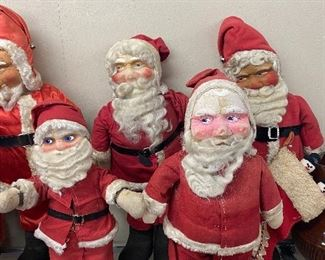 Several Early Mask Face Santas in Various Conditions