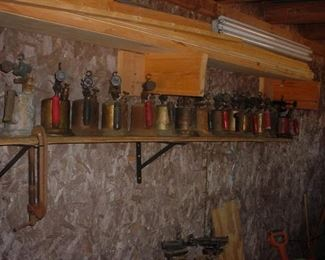 Dozens and dozens of old brass, copper and other blow torches