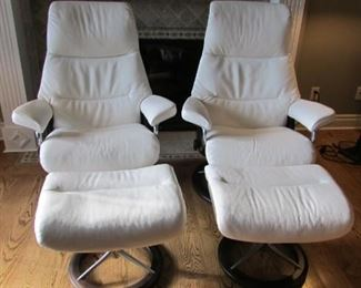 """Two Stressless Mayfair white leather upholstered recliners with ottomans. Like new.  Chair H 42 ½"""", W 33"""", D 23"""" $1,500 each"""