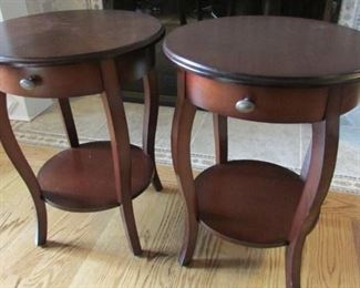 """Pair walnut finished round side tables.  Minor scuffing to the legs and one with scratch on the lower shelf. H 24"""", diameter 18 ½"""" $130 pair"""