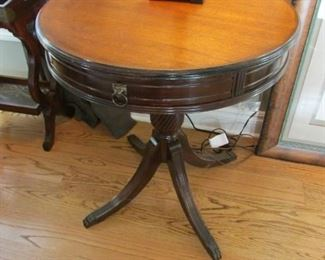 Mahogany drum table.  With one apron drawer.  Minor scratches on top and faint water ring.  $65