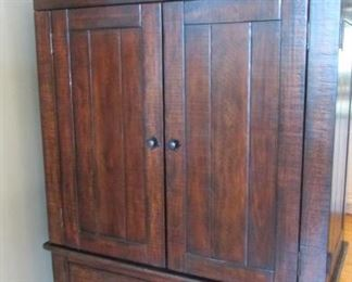 """Oak armoire or television cabinet.  With small dent to the edge of the top.  H67"""", W 47 ½"""", D 24""""  $225"""