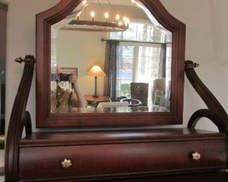 "Large mahogany finished dressing mirror.  H 29"", W 28"", D 11 5/8"" $125"