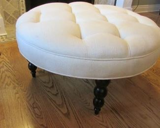 "Linen upholstered button tufted ottoman. The linen with a watermark.  H 17"", Diameter 35"" $200"