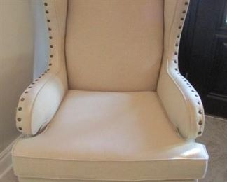 """Linen upholstered wing chair with nail head trim. With stain on one arm rest.  The back leg is loose.  H 47"""",          W 30"""", D 31 $200"""