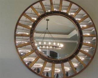 "Round gilt wood and mirrored paneled framed beveled mirror.  Diameter 34 1/2"" $350"