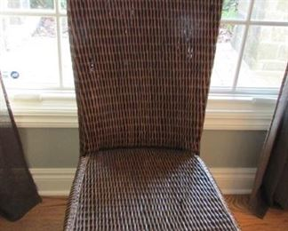 "Woven rattan high back side chair.  The rattan is split in 2 places on the seat.  H 42"", W 19"", D 18"" $50"