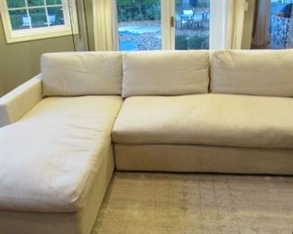 """Restoration Hardware down filled sectional sofa.  Cream cotton upholstery.  Few minor spots to the armrests.  The front apron is slightly discolored.  H 31"""", L 106"""", D 41 ½"""", chaise L 73"""" $2,300"""