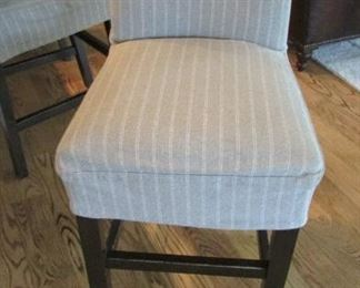 """Five Quatrine bar stools.  With linen cotton slip covers.  With minor wear to the cross bars.  H 42"""", W 20"""", D 21 ½"""" $125 each"""
