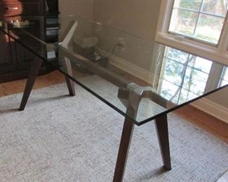 """Crate and Barrel strut bourbon glass top table.  H 31"""", W 70"""", D 34"""" $400"""