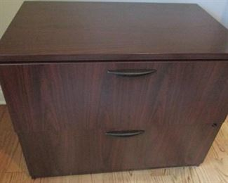 """Rosewood laminate file cabinet.  Front corner is chipped.  H29"""", W 70"""", D 34"""" $40"""