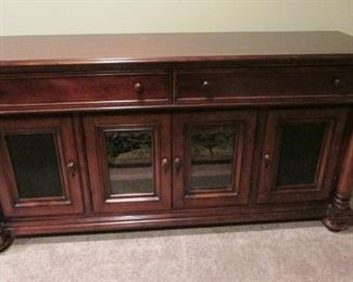 "Thomasville mahogany media cabinet.  Scratches on top.  H 33"", W 66"", D 19 ½"". $300"