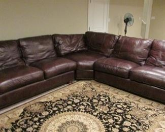 """Thomasville leather sectional sofa.  Minor wear on the cord trim of the seats. Each side 114"""" $1,000"""