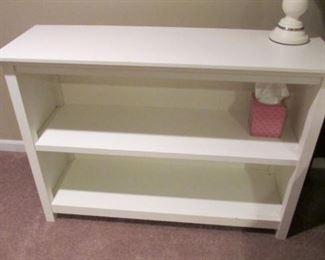 "White bookshelf.  The finish is worn. H 29"", L 42"", D 14"" $30"