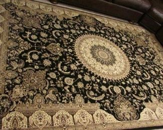 """Oriental style synthetic machine made rug.  9'6"""" x 6'7""""  $200"""