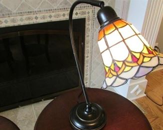 """Bronze finished and leaded glass table lamp.  H 18 ½"""", shade length 7 ½"""", Diameter 6 ½"""" $70"""