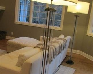 """Two Restoration Hardware Flatiron bronze finished and glass floor lamps. With white linen shades. H 75"""" $400 each"""