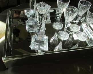 """four small Waterford crystal wines. H 6 1/4"""" $60          Pair Miller Rogaska crystal candlesticks. H 8"""" $27"""