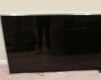 "Samsung wall mounted 60"" television. 31"" x 53 3/4"" $200"