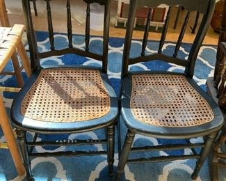 #43(2) Black wood Chairs w/cane Seating  - sold as a pair $50.00