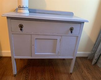 #119Blue Painted Cabinet w/1 drawer & 1 door (missing knob) - on wheels  36x18x32 $75.00