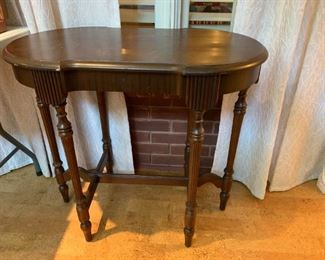 #133Oval Radio Table  as is top finish - 32x19x29 $100.00