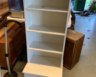 #144White Laminate 4 shelf & 2 drawers cabinet  16x12x44 $25.00