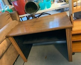 #148computer table w/outlet in back  35x23x25 $20.00