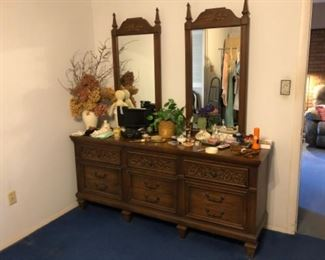 Master bedroom dresser has matching headboard and night stands
