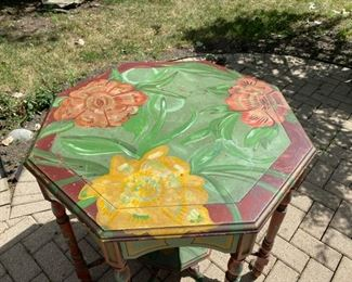 "Painted floral octagonal table                                          325.00   30""h x 32"" w"