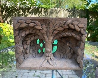 Folk art wood carving Eve at the apple tree