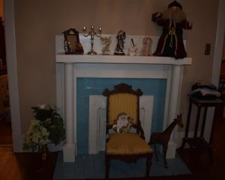 Antique Fireplace Mantle (nfs) surrounded by an Antique Victorian Chair and many Collectible items